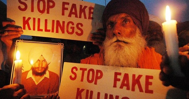 Indian Sikh, Jagir Singh (68) holds a picture of his son Sukhpal Singh, who was allegedly killed in a fake encounter in 1994 as members of the Human Rights Front protest against the alleged extra-judicial killings of several youth in fake encounters during the militancy days in the Punjab, in Amritsar, 10 May 2007 and demanded a high level probe into the alleged fake encounters.  The human rights body has alleged that more then 1000 youth were killed by Punjab Police from 1984 to 1995.  AFP PHOTO /NARINDER NANU (Photo credit should read NARINDER NANU/AFP/Getty Images)